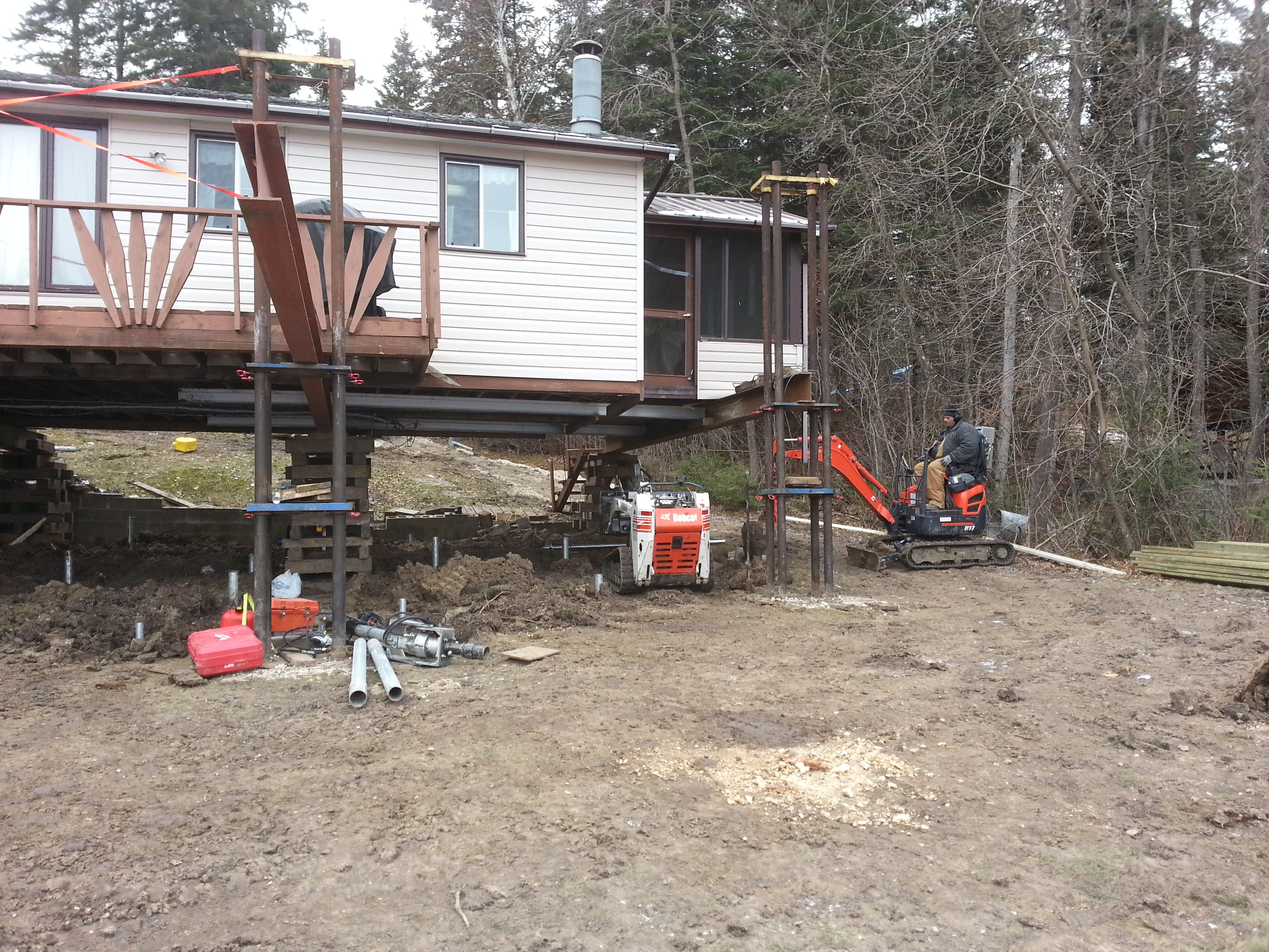 Screw pile foundation under existing cabin in bird lake for Foundation pilings