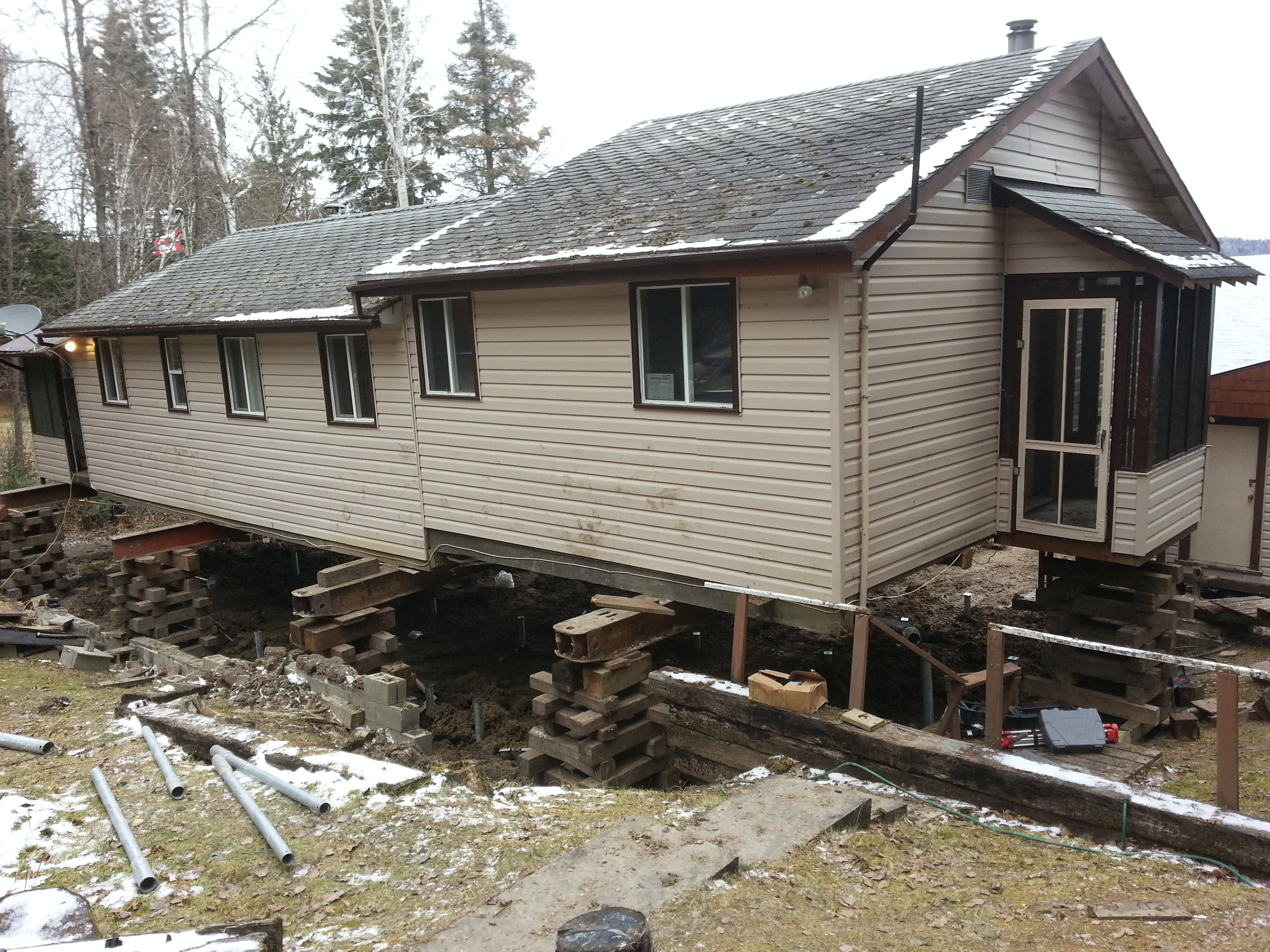 Screw pile foundation under existing cabin in bird lake House piles