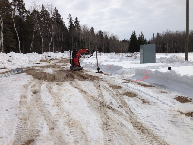 Drilling Through Frozen Soil to Allow Installation of Helical Screw Piles - Postech Winnipeg