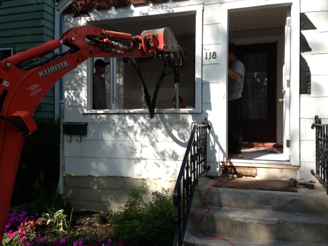 Postech Winnipeg Installing Heavy Duty Ground Anchors to Stabilize a Porch in Wolsley