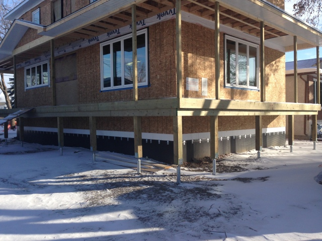 Wrap Around Country Porch on Screw Piles in Winnipeg Manitoba